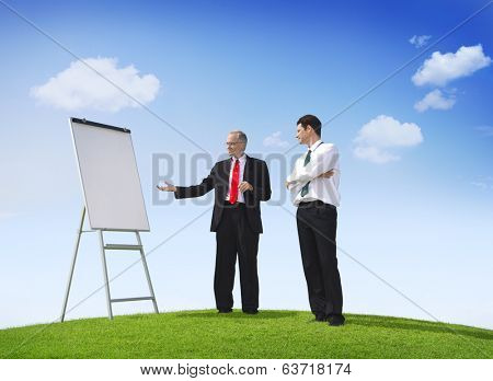 Business Man Pointing At Empty Whiteboard Outdoors