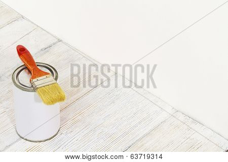 Paintbrush And Can, Paint Brush And White Color Container On Wooden Floor Background