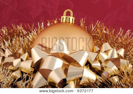 Gold Christmas Ornament Garland And Bows