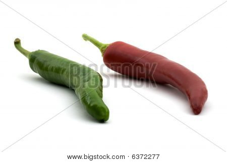 Long Hot Red And Green Peppers Isolated On White Background