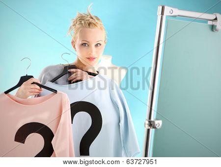Shopping dilemmas - a woman in dressing room .