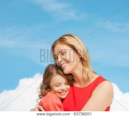 family, child and happiness concpt - hugging mother and daughter