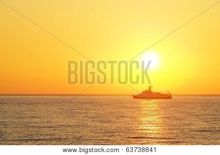 Cargo Ship  Against Colorful Sunset
