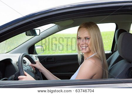 Happy Young Beautiful Woman Driving Car
