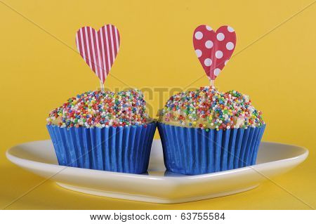 Bright And Cheery Red Blue And Yellow Theme Cupcakes With Hundred And Thousands Candy Topping And He