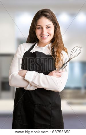 Female Cooker With Apron Smiling