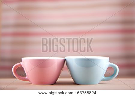 couple cups of soft background symbol for men and women