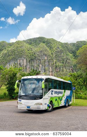 VINALES, CUBA - APRIL 15, 2014: Tour bus at the Vinales Valley in Cuba, a famous touristic landmark worldwide known for its unique natural beauty and the quality of its tobacco plantations