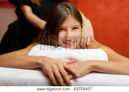 Young woman receiving a massage in a spa