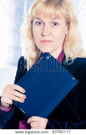 Beautiful businesswoman portrait with tablet in office