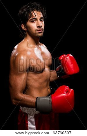 Male boxer in red. Studio shot over black.