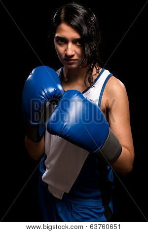 Female boxer in blue. Studio shot over white.