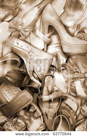Lots of old gold color shoes. Shoe background.