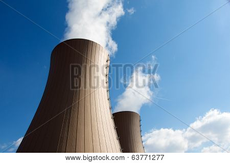 Nuclear Power Plant Against  Clouds And Sky