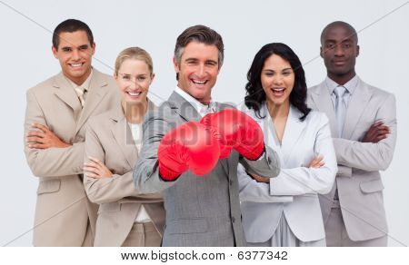 Smiling Businessman With Boxing Gloves Leading His Team
