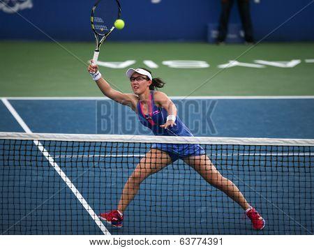 KUALA LUMPUR - APRIL 19, 2014: Zheng Saisai returns in the semifinals of the BMW Malaysian Open tennis in Kuala Lumpur, Malaysia. Partnering Chan YungJan, they beat Olga Savchuk and Lyudmyla Kichenok.