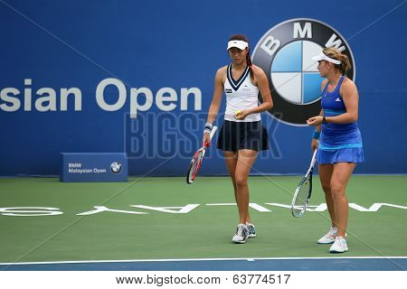 KUALA LUMPUR - APRIL 20, 2014: Timea Babos of Hungary (blue) discusses Chan Hao-Ching of Taiwan at the doubles final of the BMW Malaysian Open Tennis in Kuala Lumpur, Malaysia. They emerge winners.