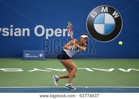KUALA LUMPUR - APRIL 20, 2014: Chan Hao-Ching of Taiwan returns at the doubles final of the BMW Malaysian Open Tennis in Kuala Lumpur, Malaysia. She partners Timea Babos of Hungary to emerge winners.