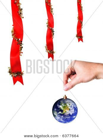 Christmas Decoration And Hand Holding  Earth