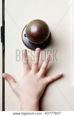 Reaching For Door Knob