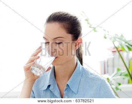 Morning. Attractive woman with glass of water