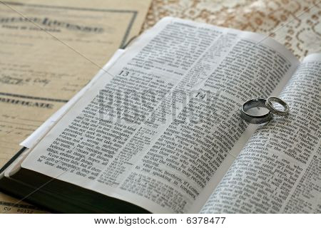 Open Bible With Wedding Rings
