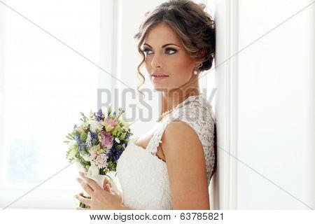 Wedding. Attractive bride with bouquet