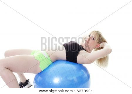blonde girl laying on ball