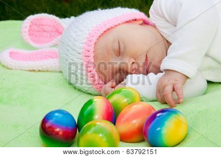 Baby In A Bunny Hat With Easter Eggs