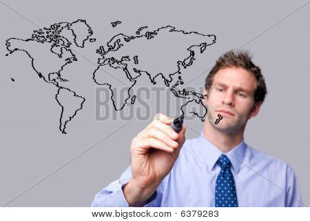 Businessman Drawing The World Map On A Glass Screen.