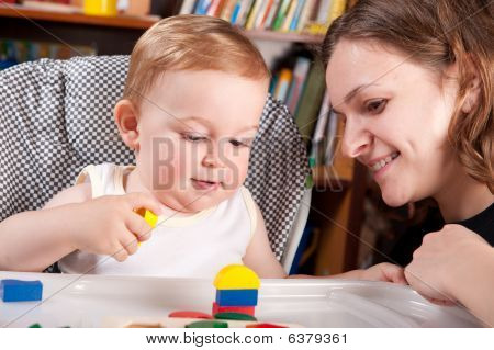 Mother Playing With Her Son In Blocks