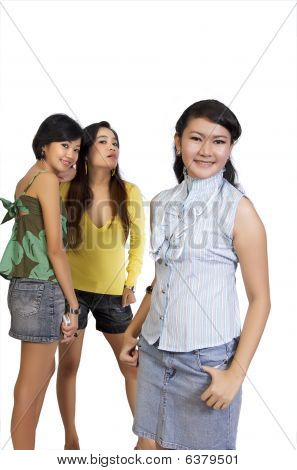 Two Girl Gossiping Behind Another Girl Back