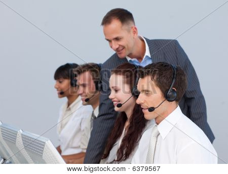 Manager And Team Working In A Call Center