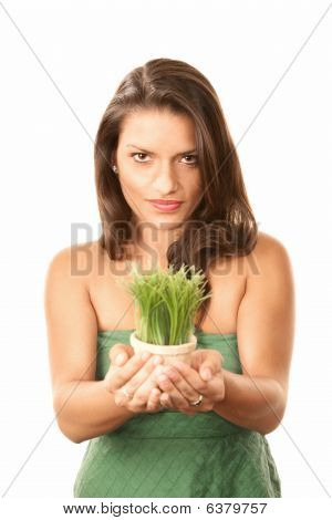 Pretty Hispanic Woman With Grass In Pot