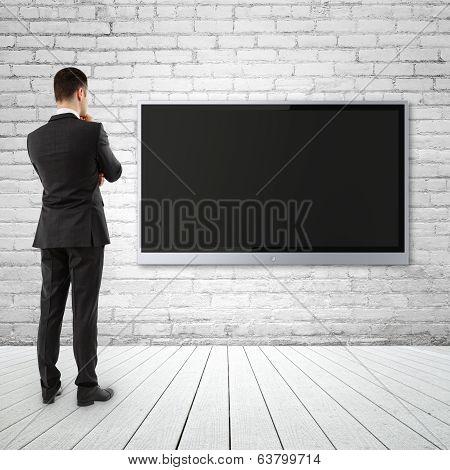Businessman Looking  Tv