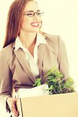 picture of box-end  - Beautiful business woman holding box with office items - JPG