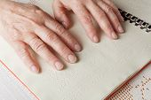 picture of braille  - Blind old woman reading text in braille language - JPG