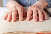 image of braille  - Blind old woman reading text in braille language - JPG