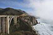stock photo of bixby  - Beautiful Bixby Bridge Big Sur California fog hanging along the edge of Hwy 1 - JPG