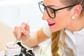 stock photo of denture  - Female dental technician or orthodontist  producing denture with imprint - JPG