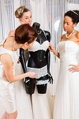 foto of night gown  - Women selecting together bridal gown and lingerie in wedding fashion store - JPG