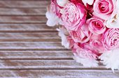 stock photo of bunch roses  - Beautiful wedding bouquet on wooden background - JPG