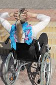 foto of physically handicapped  - A young female Wheelchair user in front of a stair - JPG
