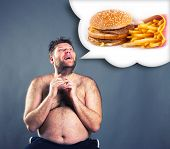 pic of hamburger  - Fat funny man dreaming about  hamburger - JPG