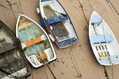 stock photo of st ives  - Small wooden boats beached high and dry on the sand by the retreating tide in St Ives harbour in Cornwall a popular fishing village and tourist resort - JPG