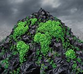 image of landfills  - Global garbage concept with a mountain of black plastic trash bags in a landfill background with a vine plant shaped as the planet earth growing through the rubbish as a metaphor for revival and hope for the health of the environment - JPG