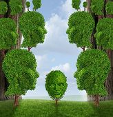 image of nurture  - Community assistance and public support concept as a group of adult human head shaped trees giving help to a young child plant as a nurturing metaphor for government social services in education and friendship - JPG