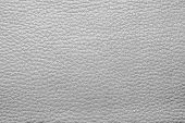 stock photo of pale skin  - abstract background from the painted texture of skin and leather fabric gray color - JPG