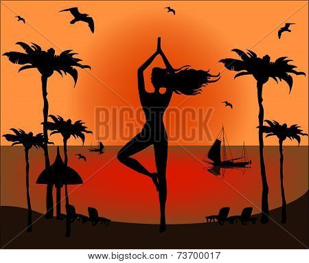 Silhouette Of Woman Doing Yoga On A Tropical Beach
