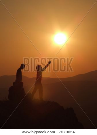 Man Stretching Arms Towards Sun